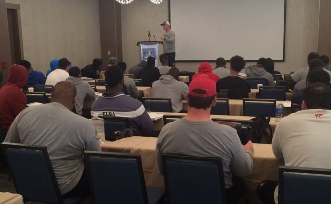 Head coach Kevin Guy addresses the team on the opening day of camp. - photo via @ArizonaRattlers on Twitter