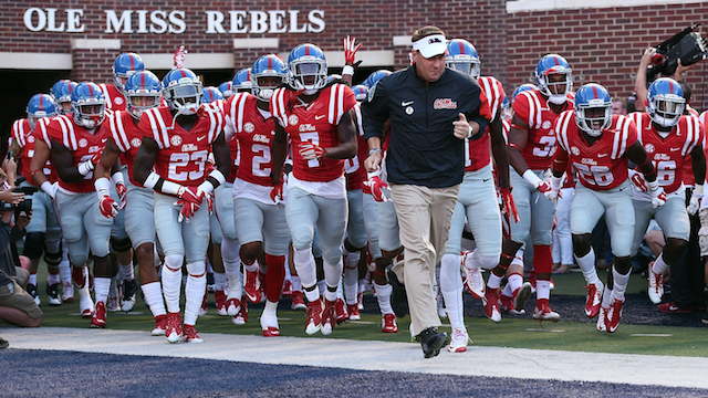 OXFORD, MS - SEPTEMBER 26:  Head coach Hugh Freeze of the Mississippi Rebels takes the field with his team prior to a game against the Vanderbilt Commodores at Vaught-Hemingway Stadium on September 26, 2015 in Oxford, Mississippi.  (Photo by Stacy Revere/Getty Images)